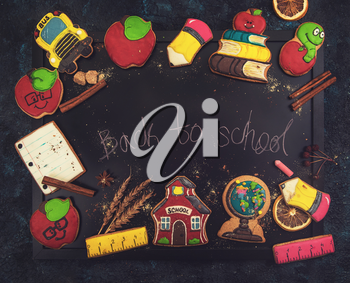 Back to school gingerbreads cookies on a dark background