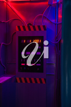 time machine with digital display in neon colors