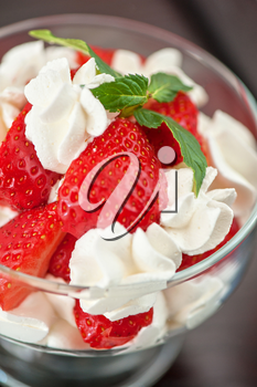 strawberry with cream closeup photo