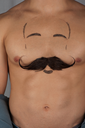 male torso with moustache and beard at chest