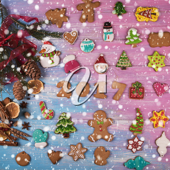 Gingerbreads for new 2017 year holiday on wooden background, xmas theme
