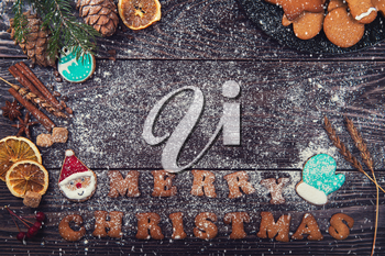 Gingerbreads for christmas on wooden background