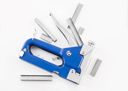 Blue staple gun with staples isolated over white background