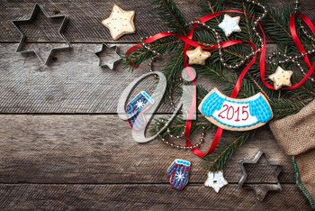 Christmas and New Year 2015 decorated cookies in rustic style on wood. Free space for text