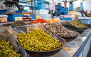 Olives on market counter in Eastern country like Tunisia, Egypt, Turkey