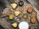 Tasty Pears almonds Cookies and milk on rustic wood. Rustic style and autumn food photo