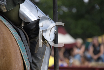 Royalty Free Photo of the Leg of a Suit of Armour on a Horse