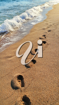 Footprints on the sandy beach, nature background