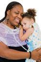 Smiling woman carrying her daughter isolated over white