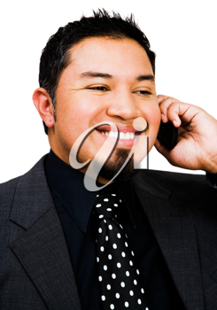 Young businessman talking on a mobile phone isolated over white