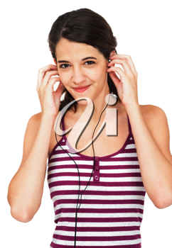 Confident woman listening to music on earbud isolated over white