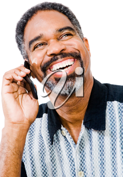 Close-up of a man talking on a mobile phone isolated over white