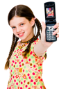 Smiling girl showing a mobile phone isolated over white