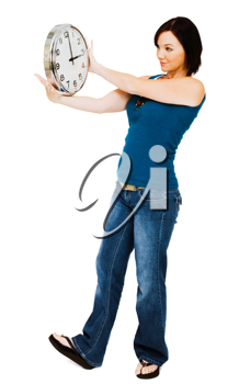 Young woman holding a clock isolated over white