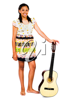 Teenage girl holding a guitar and smiling isolated over white