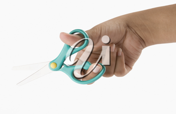 Close-up of a woman's hand holding scissors