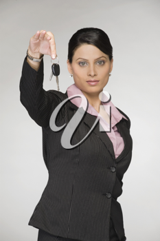 Portrait of a businesswoman showing a car key