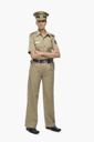 Portrait of a female police officer with her arms crossed