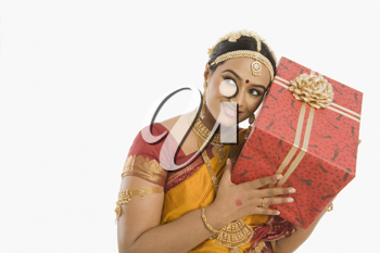 South Indian woman holding a gift box