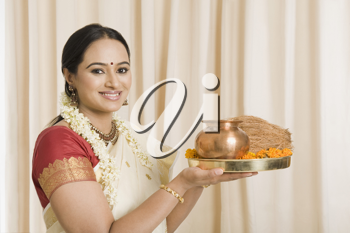 South Indian woman holding pooja thali
