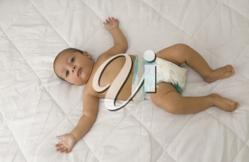 High angle view of a baby boy lying on the bed