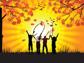 Royalty Free Clipart Image of Children in Silhouetted on an Autumn Landscape