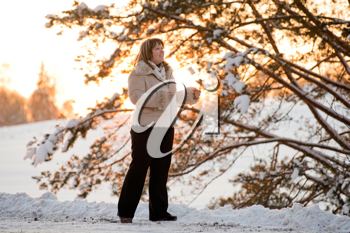 Royalty Free Photo of a Woman Outside at Sunset