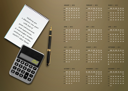 Royalty Free Photo of a 2012 Calendar Including a Calculator, Pen, and Notepad