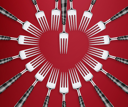 Empty copy space of Set of forks in competition on red  background.
