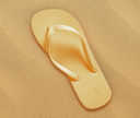 a pair of flip flops on the beach sand, Summer back concept.