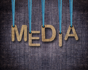 Royalty Free Photo of a Blue Sackcloth Background With Hanging Letters Spelling Media