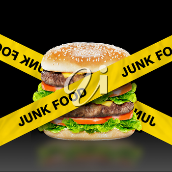 Junk Food, burger with warning message on black background