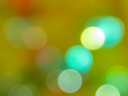 Abstract  background. Bokeh in a green-orange palette.