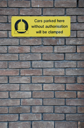 Royalty Free Photo of a Yellow Parking Sign