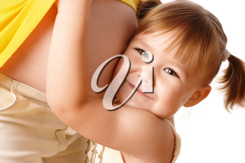 Royalty Free Photo of a Little Girl Hugging Her Expectant Mother