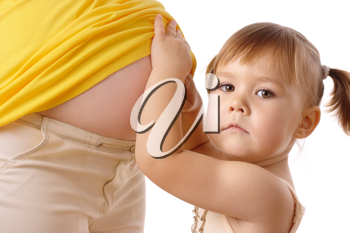 Royalty Free Photo of a Little Girl and a Woman's Pregnant Belly