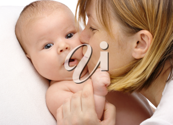 Royalty Free Photo of a Mother Kissing Her Baby