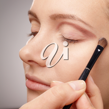 Royalty Free Photo of a Woman Having Eyeshadow Applied