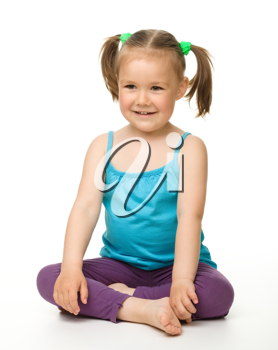 Royalty Free Photo of a Little Girl Sitting on the Floor