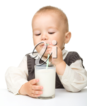Royalty Free Photo of a Little Boy With a Glass of Milk