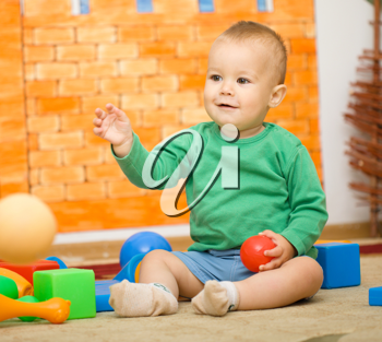 Royalty Free Photo of a Baby Boy Playing With Toys