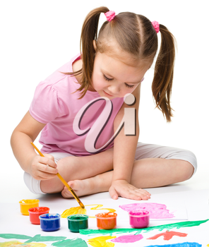 Cute cheerful child play with paints, isolated over white