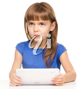 Surprised young girl is using tablet while studying, isolated over white