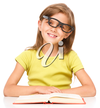 Cute little girl is wearing glasses, isolated over white