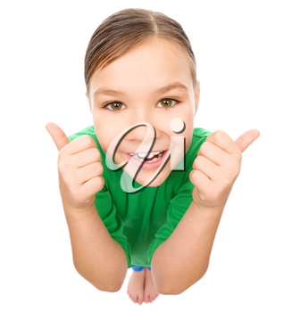 Little girl is showing thumb up gesture using both hands, fisheye portrait, isolated over white
