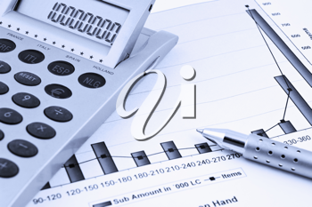Close up of a calculator, Business  Chart and pen.