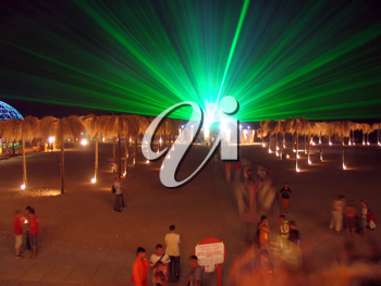 Royalty Free Photo of a Green Laser at a Beach
