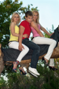Royalty Free Photo of Two Women and a Young Man on a Branch