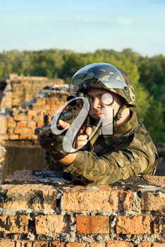 Royalty Free Photo of a Soldier With a Machine Gun