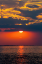 Red sunset over a calm sea bay surface